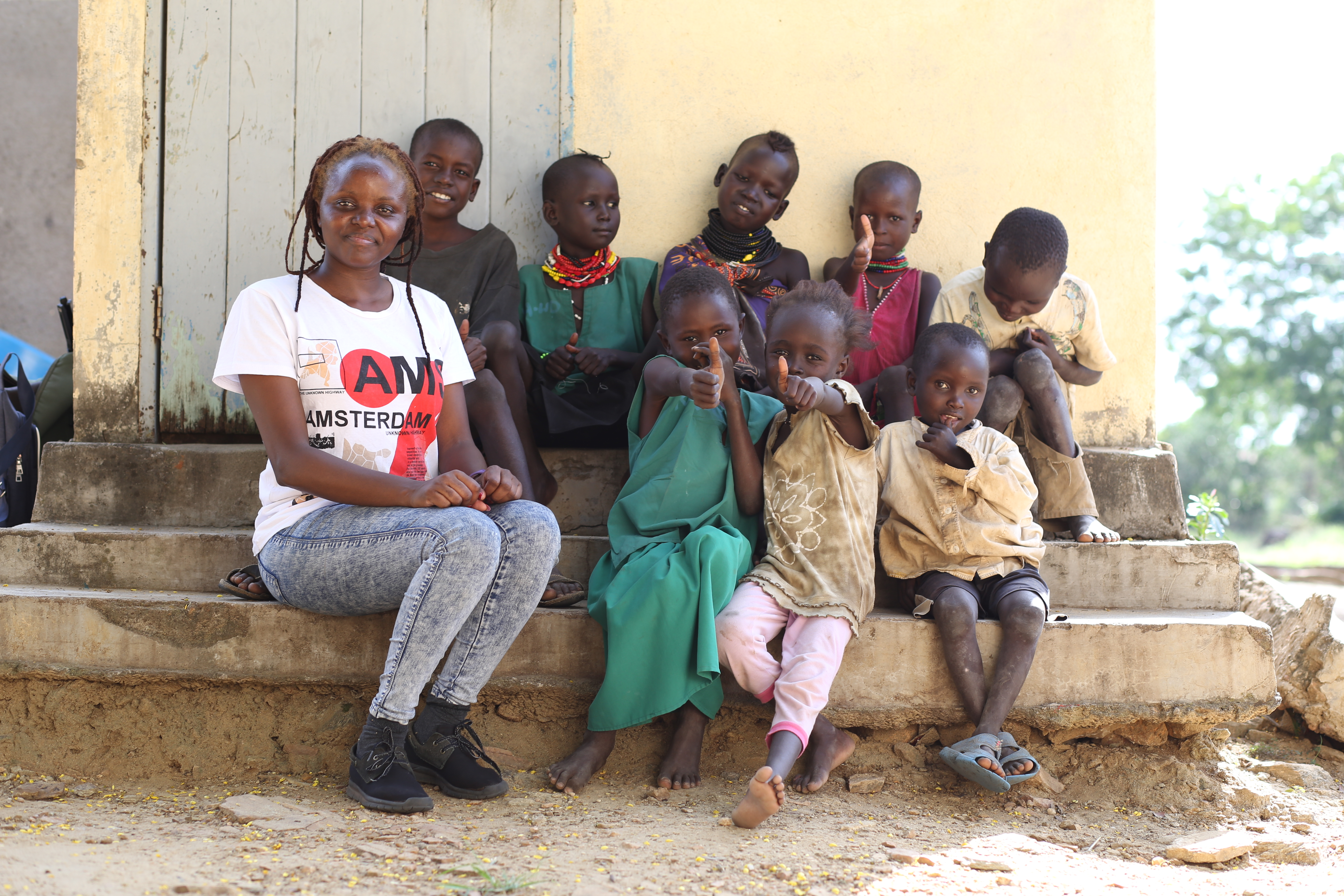 Okeyo with children who have survived the treatment of kalaazar.