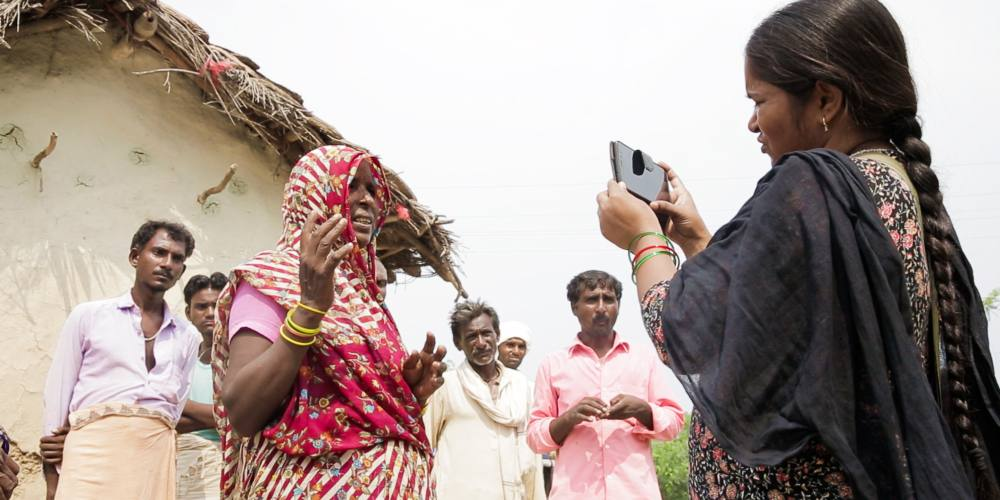 Mera Devi, one of the reporters at Khabar Lahariya, records a story
