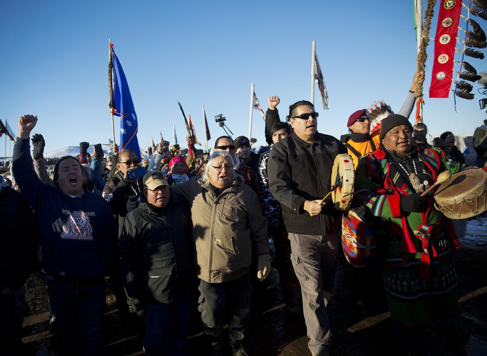 Protesters march at Oceti Sakowin camp