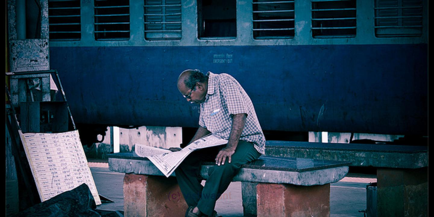 Man and newspaper