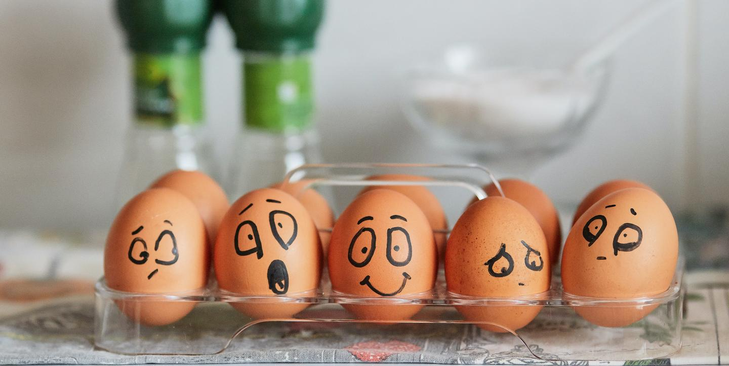 Eggs painted to show a variety of emotions