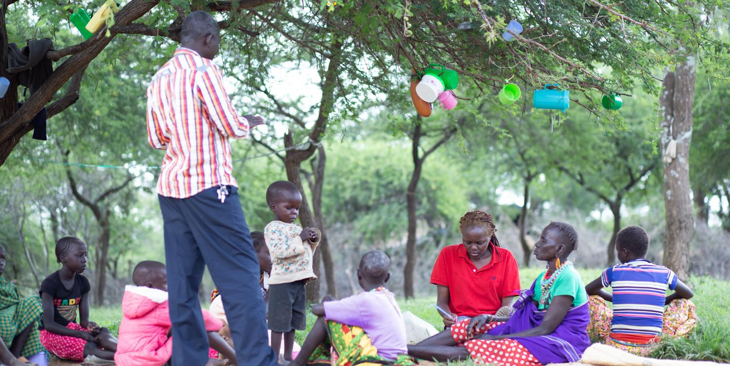 Okeyo conducts an interview with mothers in Kacheliba hospital in arid West Pokot County