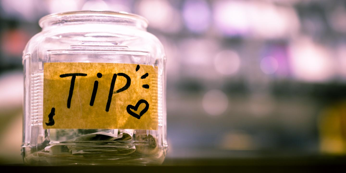 Tip jar with money in it