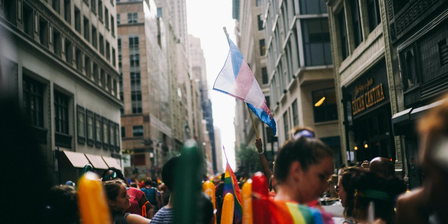 Trans flag in crowded street