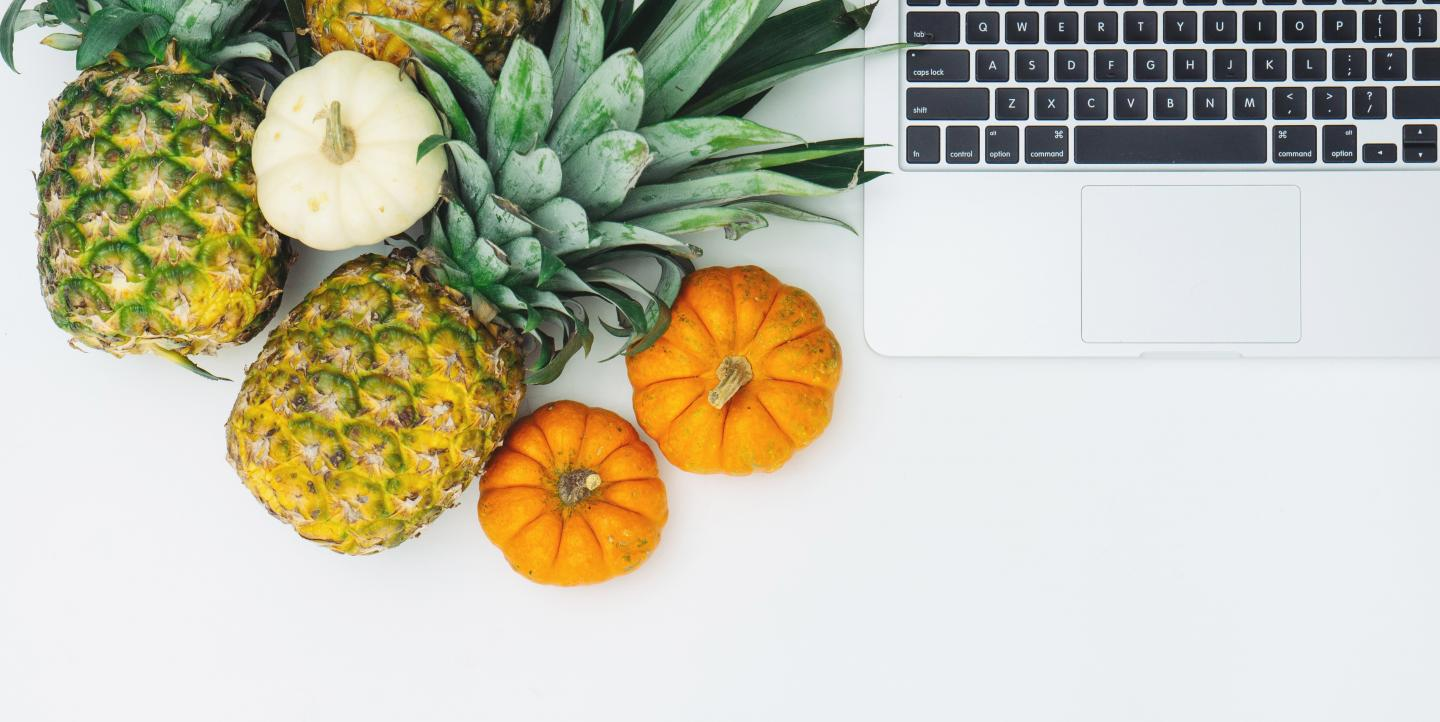 Fruits next to computer