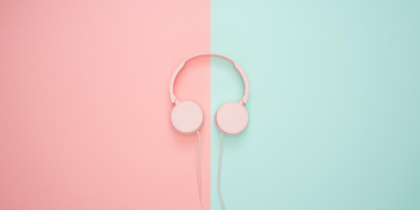 Audio headset on pink and blue background