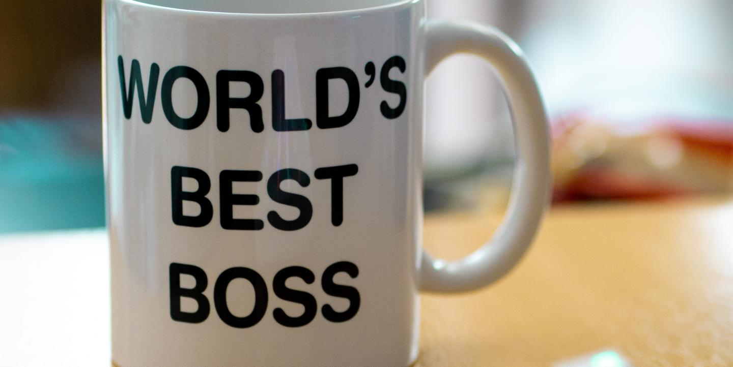 "White mug that reads ""World's Best Boss"""