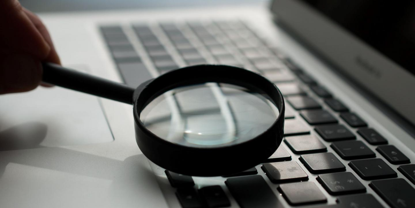 Magnifying glass and computer